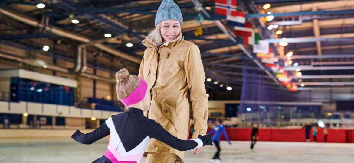 girl-ice-skating-with-mother-UHKTDAX.1